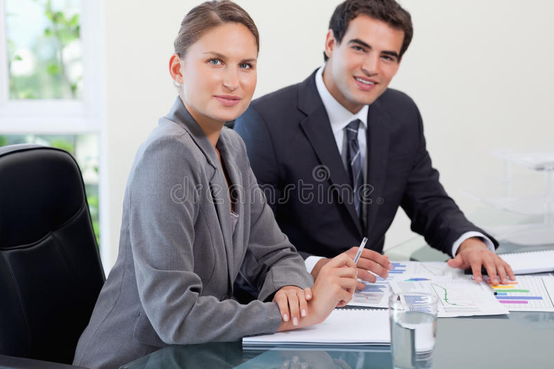 Young Business Team Studying Statistics Stock Image