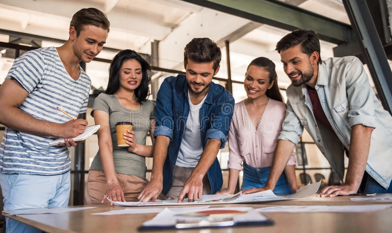 Young business team working stock photos