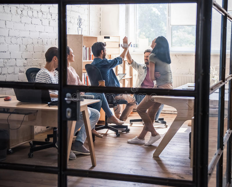 Young business team working stock image
