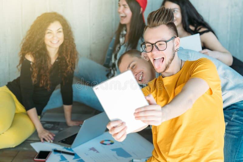 Young business team working taking selfie break stock image