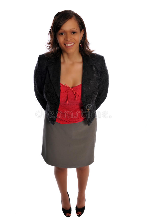 Young business woman. A young business woman in casual dress against a white background royalty free stock photos
