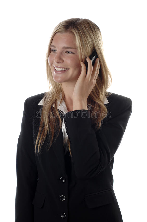 Young business woman. Fresh and energetic business woman wearing black suit photographed over white background royalty free stock images