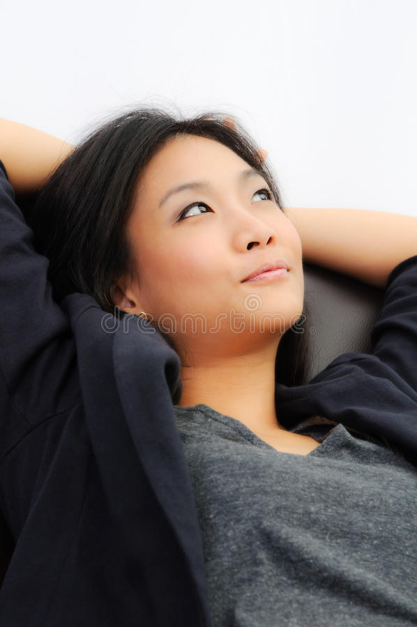Young business woman. Successful young business woman thinking on the chair royalty free stock image