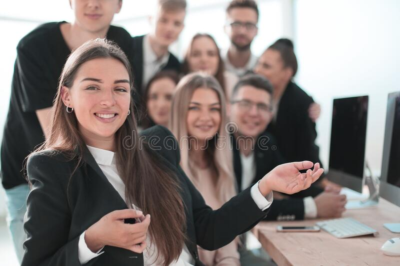 Young business woman on the background of her colleagues royalty free stock photography