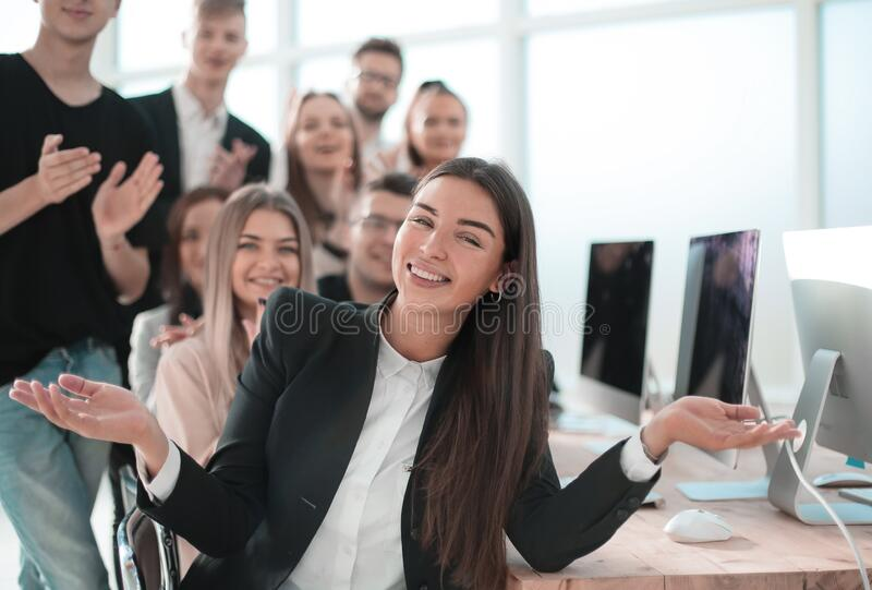 Young business woman on the background of her colleagues stock photography