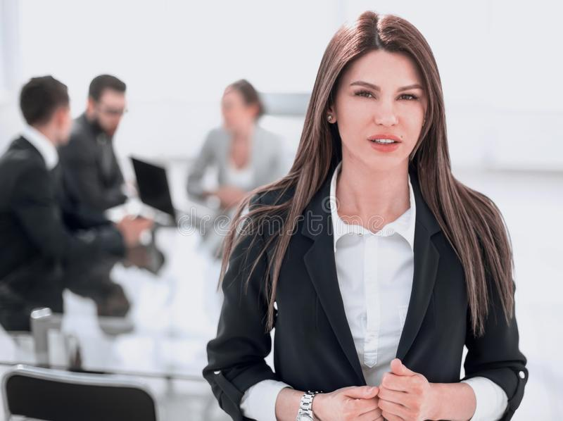 Young business woman on the background of the office royalty free stock photography