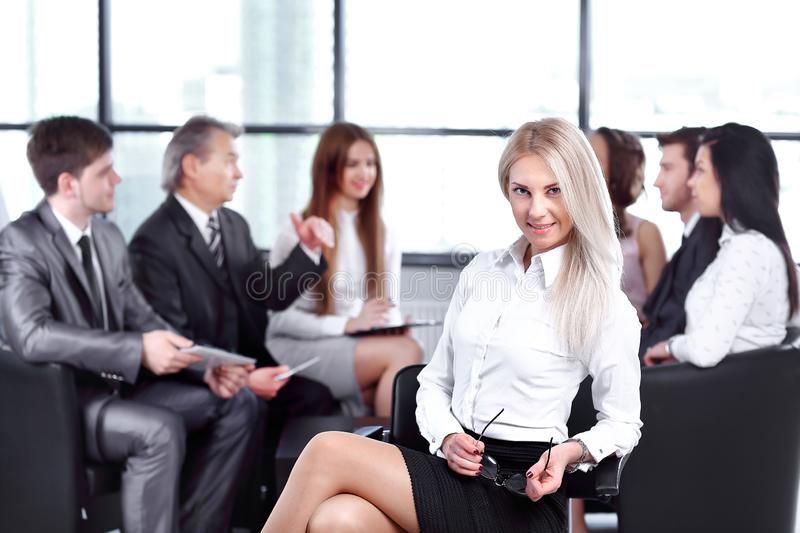 Young business woman on the background of the working group. Young business women on the background of the working group.start-up stock image