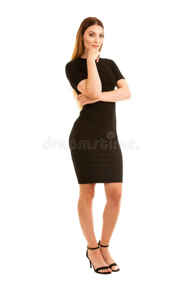 Young business woman in black dress isolated over white background full length photography royalty free stock photos
