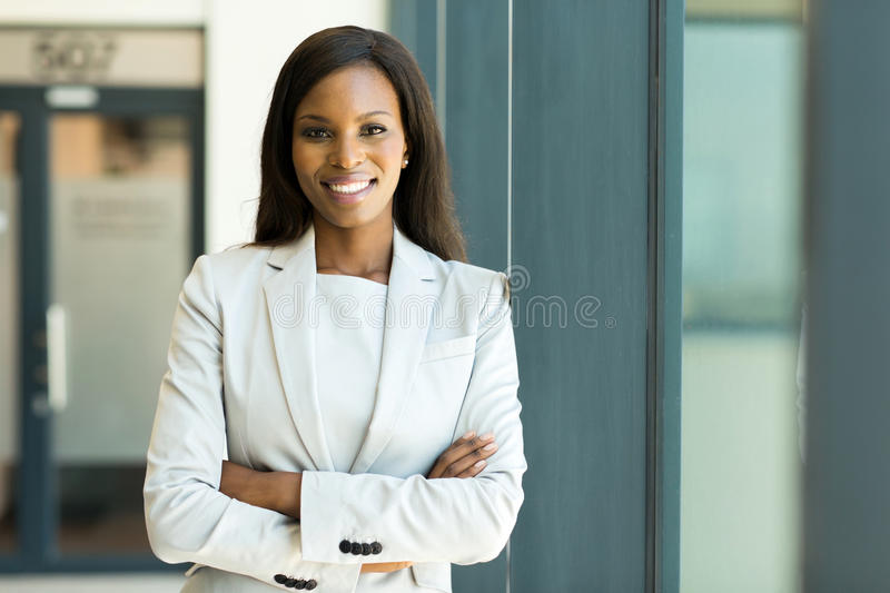 Young business woman. Close up portrait of young business woman in modern office royalty free stock photography