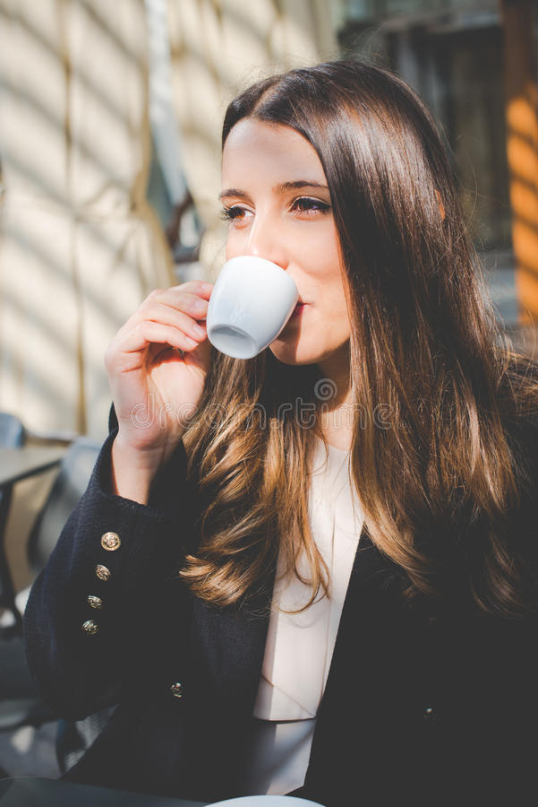 Young business woman coffee break in the city stock photography