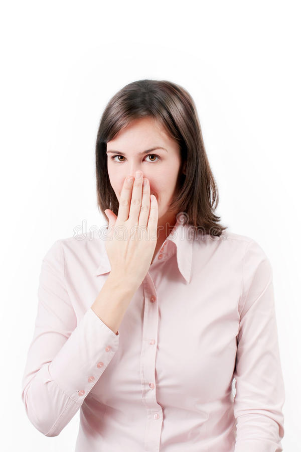 Young business woman covering with hand her mouth. stock image