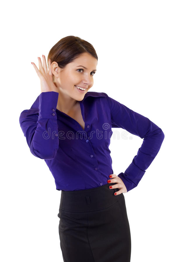 Young business woman cupping hand behind ear stock photo