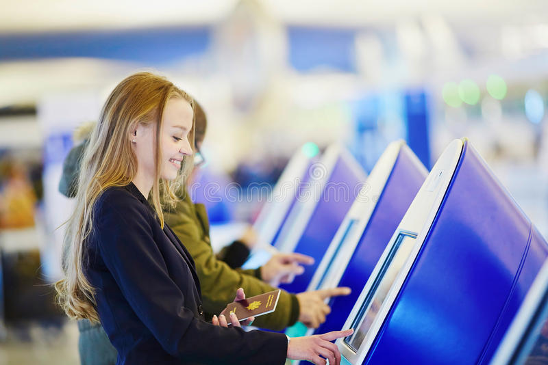Download Young Business Woman Doing Self Check-in In International Airport Terminal Stock Photo - Image: 83723069