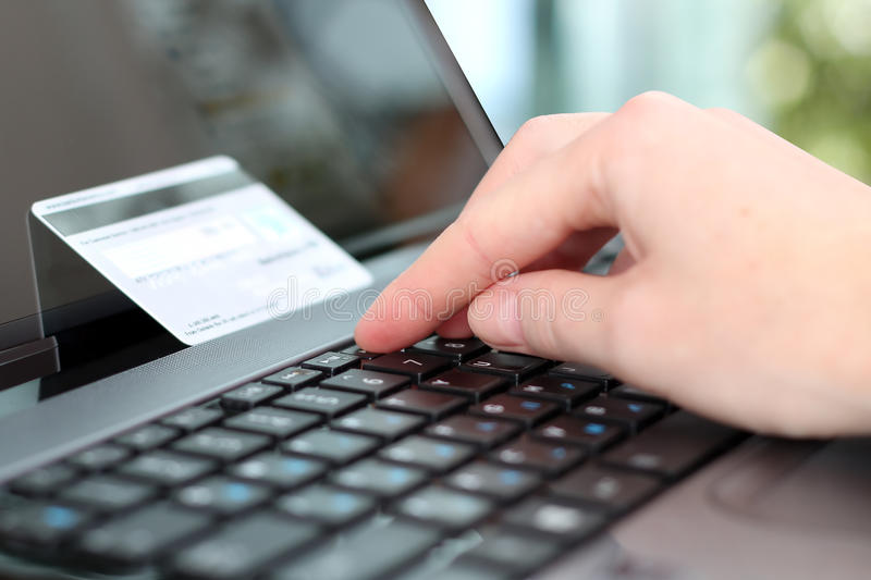 Young business woman entering data of a credit card . On-line. Shopping on the internet using a laptop royalty free stock photos