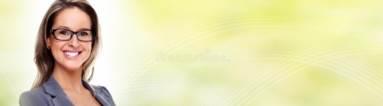 Young business woman face with eyeglasses. Beautiful young business woman over abstract green background stock photo