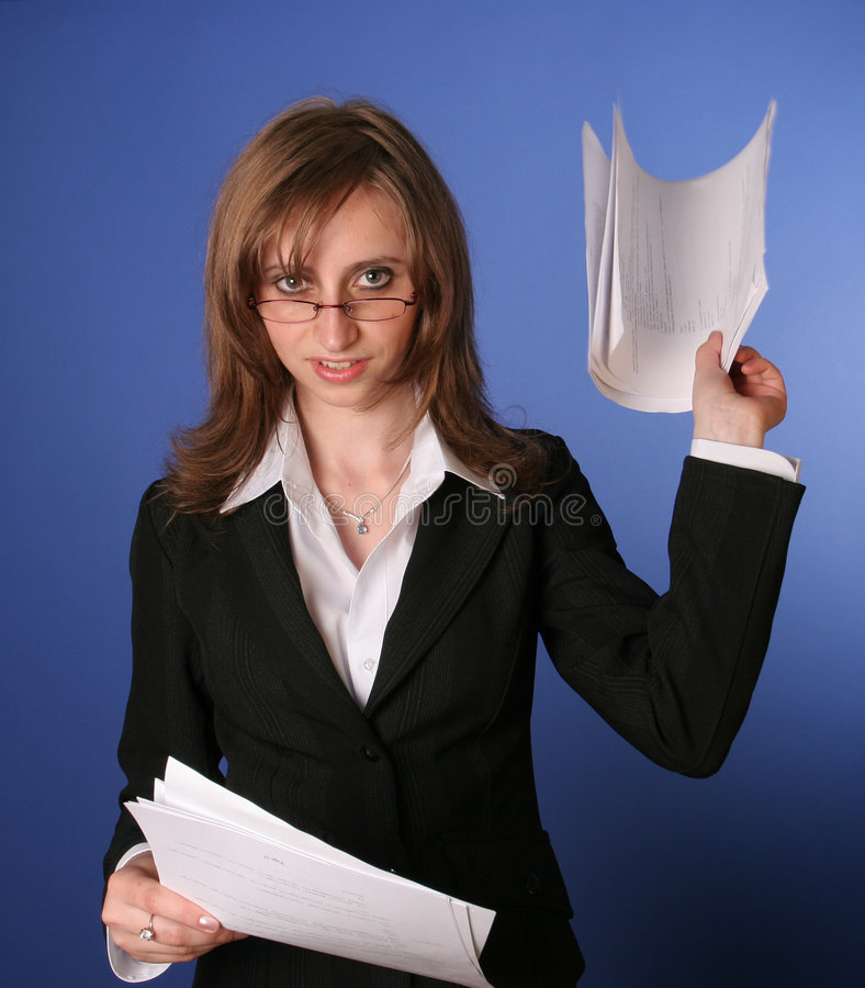 Young business woman with a file in her hands royalty free stock photo
