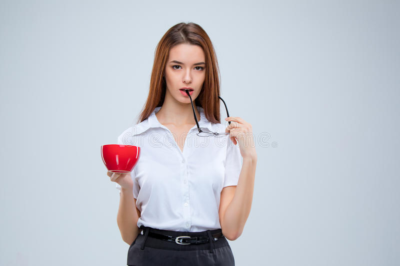 The young business woman on gray background royalty free stock photo