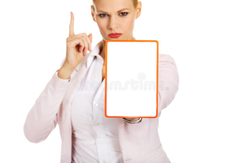 Young business woman holding a board with ban.  stock photos