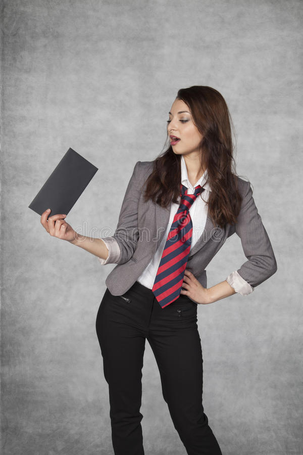 Young business woman holding an envelope with a bribe. Young businesswoman holding an envelope with a bribe royalty free stock photo