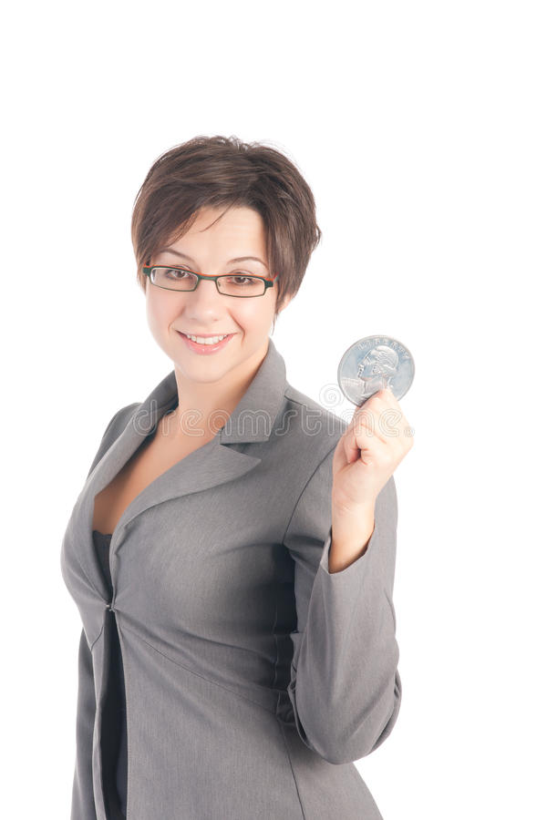 Young business woman holding quarter dollar. Modern young woman in business suit holding quarter dollar coin stock photography