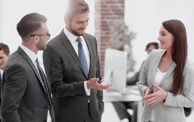 Young business woman introduces herself to client. royalty free stock image