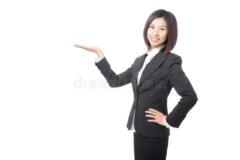 Young business woman introducing something. Isolated on white background, model is a asian beauty stock photo