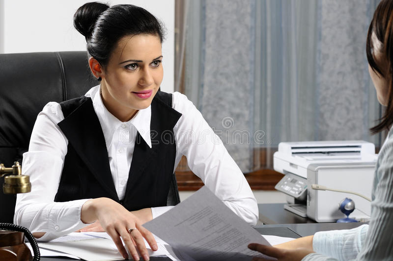 Young business woman listening stock photography