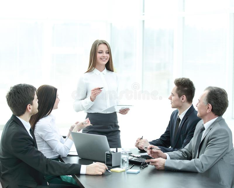 Young business woman makes a report on the working meeting royalty free stock photos