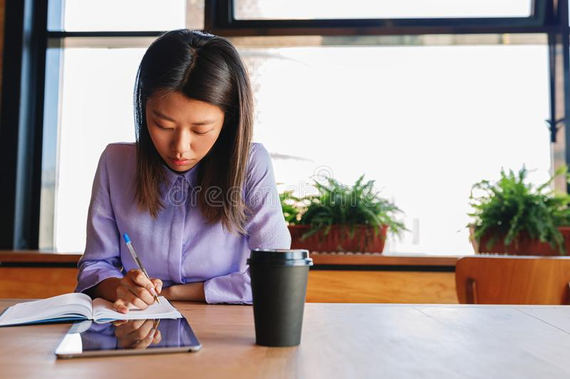 Young business woman making notes royalty free stock photos