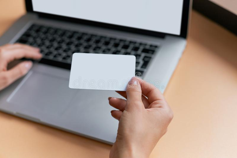 Young business woman making online payment with credit card and representing concept of new age in banking stock photo