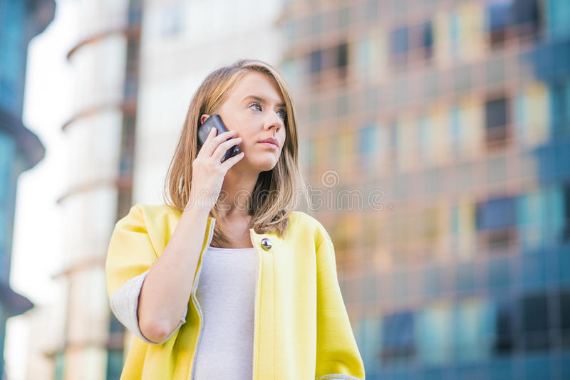 Young business woman making a phone call on her smart phone stock photos