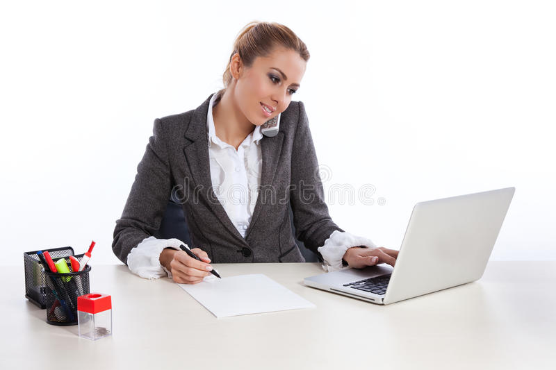 Young business woman at office calling by telephon stock photo