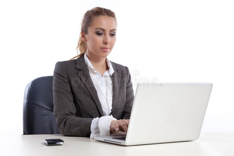 Young business woman at office with laptop royalty free stock images