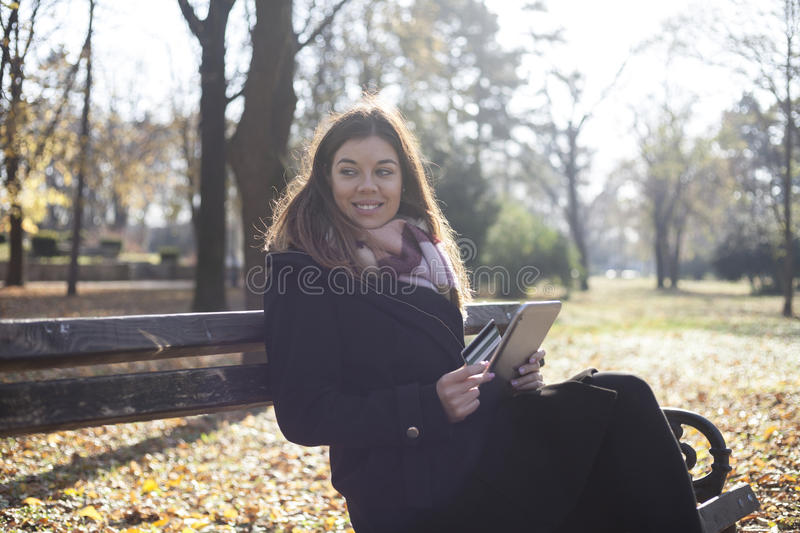 Download Young Business Woman In The Park Buys Online Stock Photo - Image: 83723554