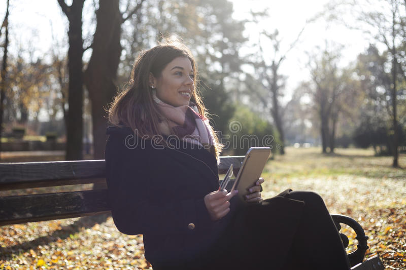Download Young Business Woman In The Park Buys Online Stock Photo - Image: 83724317