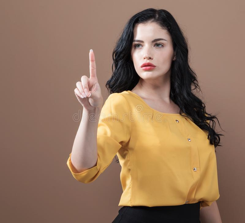 Young business woman pointing something stock photography