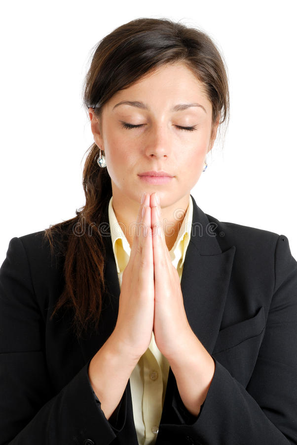 Young business woman praying royalty free stock photo