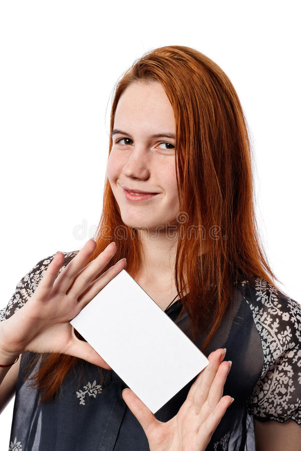 Young business woman presenting tilted white card. royalty free stock photo