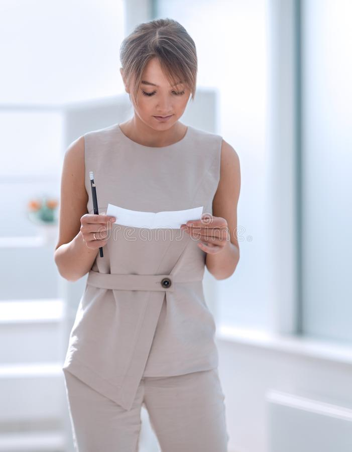 Young business woman reading a work note royalty free stock photo