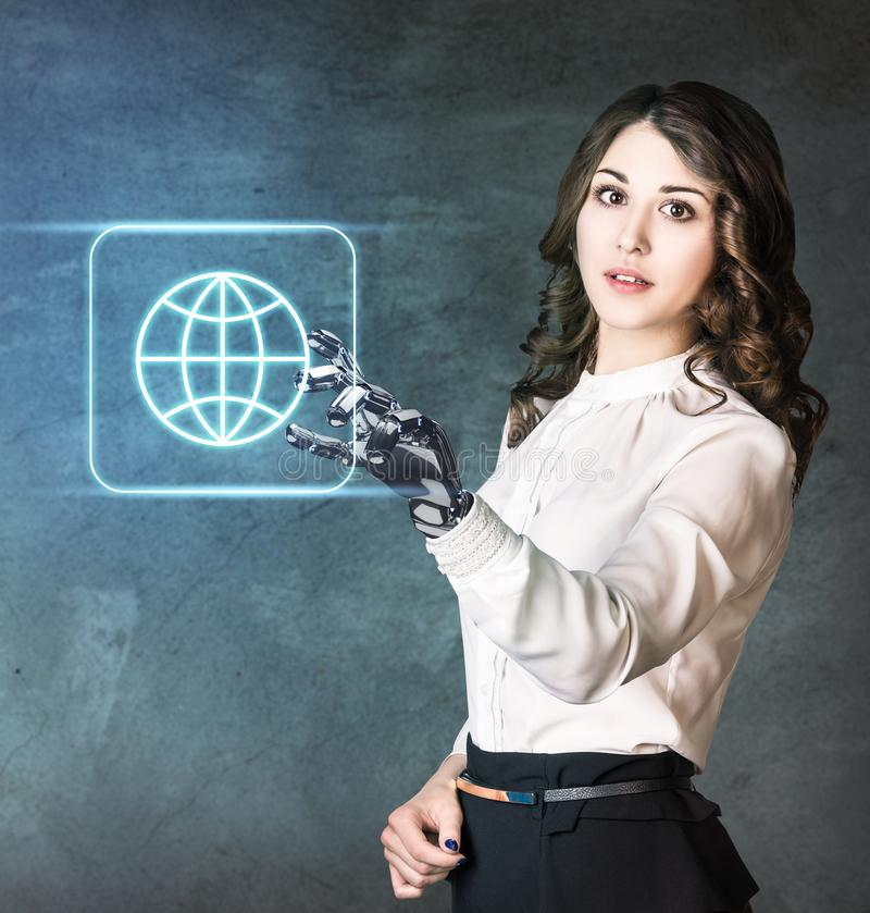 Young business woman with robot hand point on icon. Hand prosthesis concept stock photography