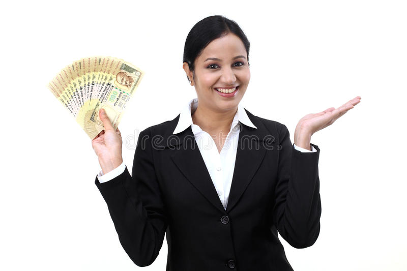 Young business woman with rupee notes in her hands royalty free stock images