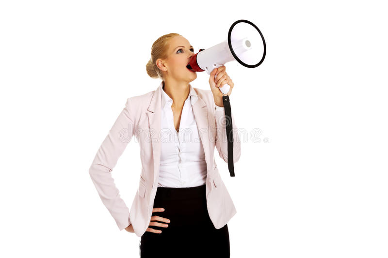 Young business woman screaming through megaphone royalty free stock photos