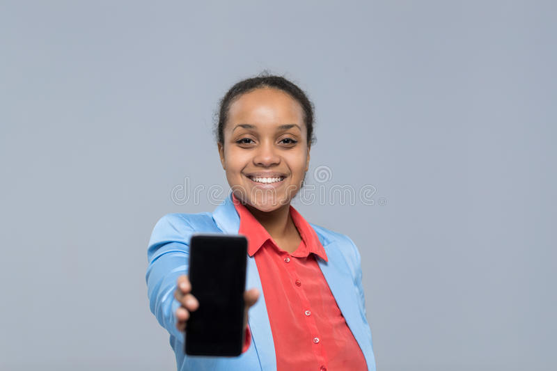 Young Business Woman Show Cell Smart Phone Empty Screen African American Girl Happy Smile Businesswoman stock photography