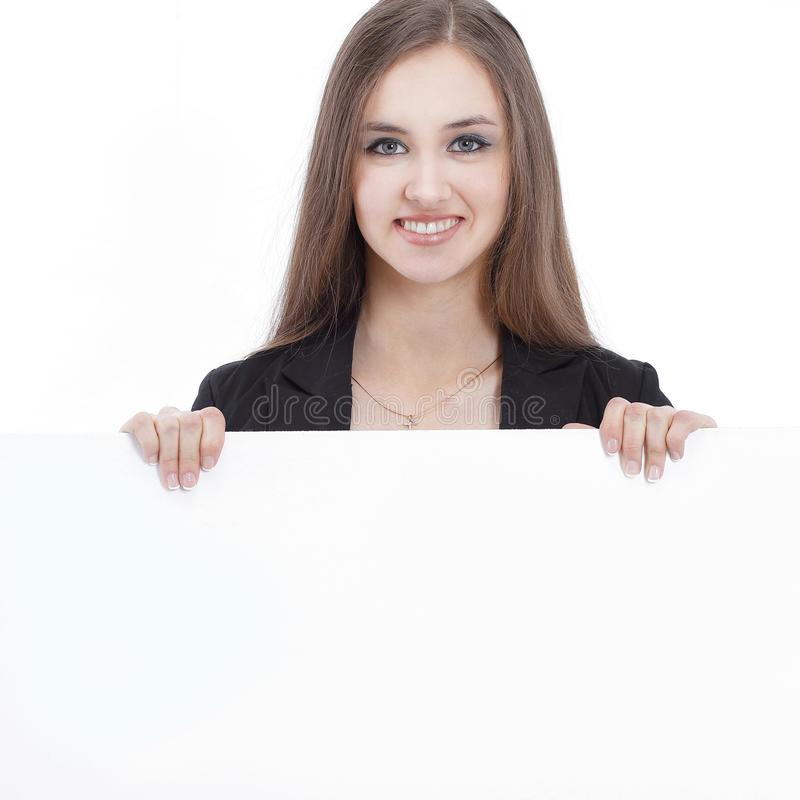 Young business woman showing blank poster. isolated on a white stock photography