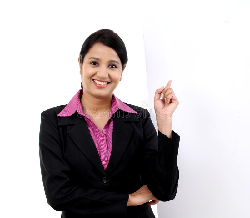 Young business woman showing blank signboard royalty free stock image