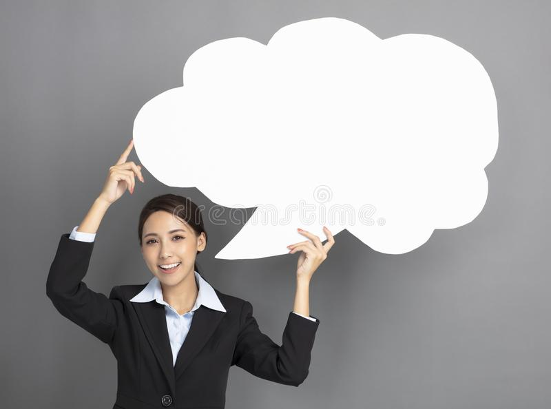 business woman showing the speech bubble stock photography