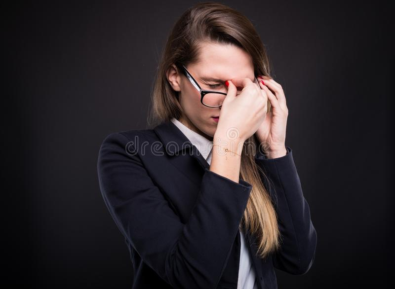 Young business woman showing stress royalty free stock image