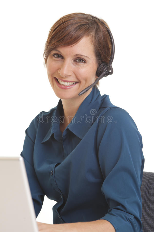 Young business woman sitting at desk stock photos