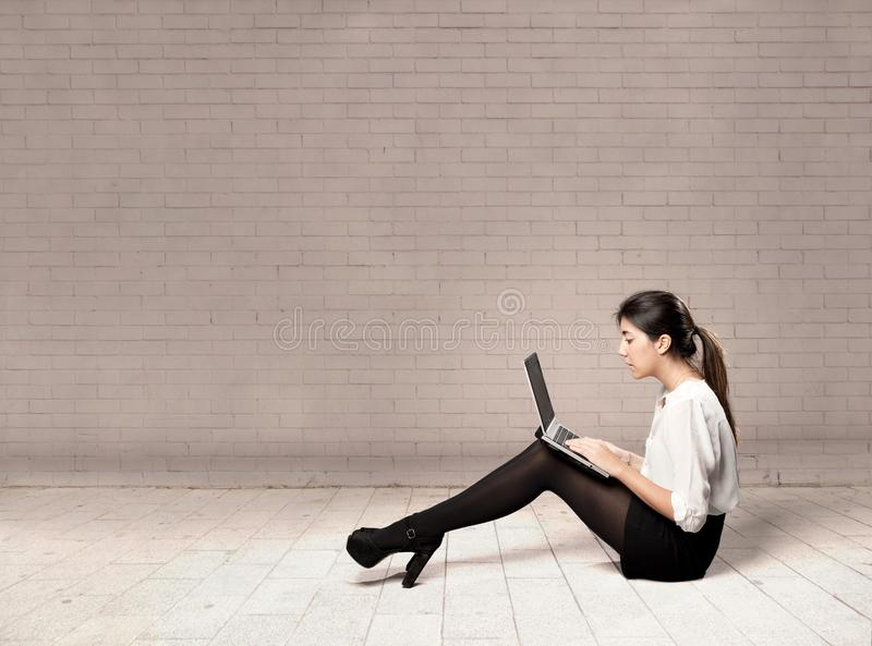 Young business woman using a laptop stock photo