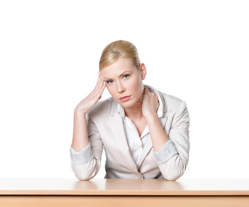 Download Young Business Woman Sitting At A Office Desk Stock Photo - Image: 28980292